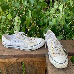 White and Gold Polka Dot Converse shoes.